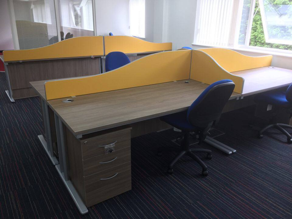 Office furniture utilising new desking, desk mounted screens and new office chairs.